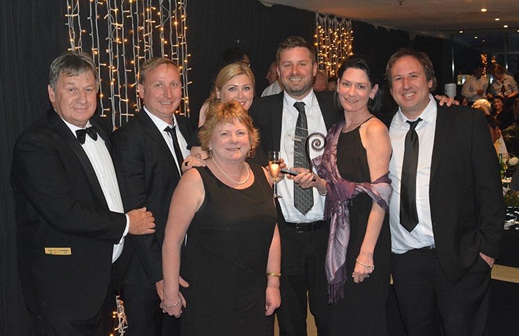 2016 Destination Queenstown Best Emerging Business Award winners, MAXRaft (L to R) Lonsdale family members Gary, Jeremy, Anne, Sonja, Henry Edney, Noelle and Craig Lonsdale
