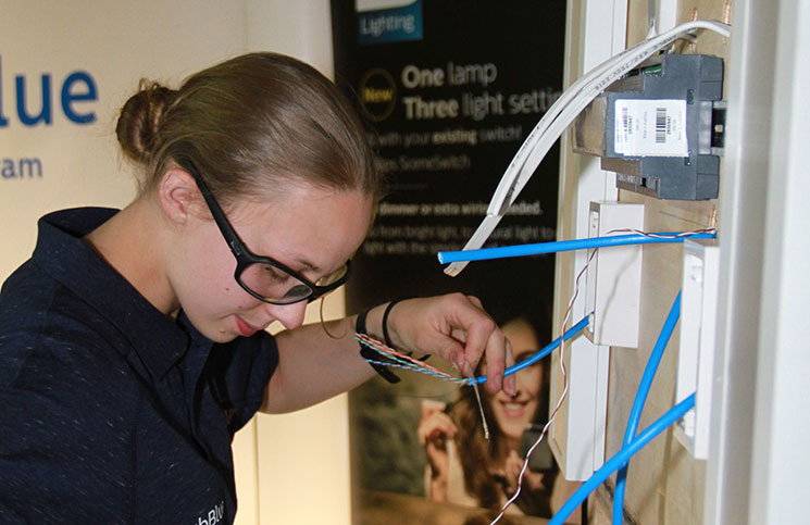 ECANZ hopes to attract more women, like apprentice electrician Sarah Pye, to the trade.